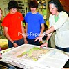 Westport Central School students (from left) Sydney Mitchell, Dominic Banis, Jeremy Lacey and William Daha get instruction from Elizabeth Lee on different aspects of maps they are creating.<br><br>(Staff Photo/Alvin Reiner)