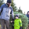 Adam Mintz and his 4-year-old son, David, carry their freshly cut balsam fir, with the help of Anthony Liberty, a worker at D&D Tree Farm in West Chazy, on a brisk Sunday afternoon recently.<br><br>(P-R Photo/Gabe Dickens)