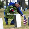 Greg Lee, a Marine who served in Vietnam and a member of the Disabled American Veterans Chapter 179, fixes an American flag before placing a wreath upon a gravestone at the Old Post Cemetery in Plattsburgh. The event, Wreaths Across America, honors fallen soldiers during the holidays at cemeteries across the nation. The American Military Retirees Association Chapter New York 1 sponsored the tribute, which also featured song, speeches and taps.<br><br>(P-R Photo/Gabe Dickens)