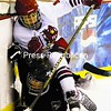 Plattsburgh State's Jenny Kistner (8) and Manhattanville's Erin Sidjak get tangled up along the boards during Saturday's non-conference women's hockey game at the Stafford Ice Arena. The Cardinals skated to a 4-0 victory with Morgan MacInnis scoring two goals.<br><br>(P-R Photo/Gabe Dickens)