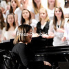 "Student teacher Michaela Bushey conducts the Plattsburgh High School's Mixed Chorus in a rendition of ""Take Me to the Water"" Monday during the Winter Concert. Bushey was injured in a diving accident that tragically left her paralyzed from the neck down.<br /> <br /> P-R Photo / Rob Fountain"