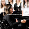 """Student teacher Michaela Bushey conducts the Plattsburgh High School's Mixed Chorus in a rendition of """"Take Me to the Water"""" Monday during the Winter Concert. Bushey was injured in a diving accident that tragically left her paralyzed from the neck down.<br /> <br /> P-R Photo / Rob Fountain"""