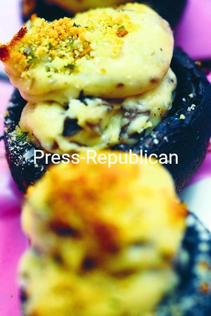 Mushrooms stuffed with an assortment of cheeses and baked to golden brown.<br><br>(Staff Photo/Kelli Catana)