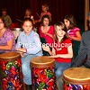 Jo Sallins demonstrates drumming techniques for Willsboro Central School students during rehearsal for a concert.<br /><br />(Staff Photo/Alvin Reiner)