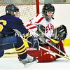Saranac Lake goalie Tyler O'Neil cuts off a scoring attempt by Dillon Savage of Lake Placid in the second period of the boys' hockey playoff game Thursday in Saranac Lake. The host Red Storm won 3-1 to reach Monday's Section VII Div. II championship game in Lake Placid.<br><br>(P-R Photo/Pat Hendrick)
