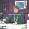 Sharon Cooke of the Barber-Cooke Agency sits in her office. The insurance agency has recently expanded by acquiring the Azer Agency of Ticonderoga.<br><br>(Staff Photo/Lohr McKinstry)