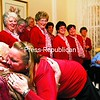 Cherie LaDuke, director of the Champlain Valley Sweet Adelines, gives the Rev. John Crable a hug during the group's performance at the Samuel F. Vilas Home in Plattsburgh. The Adelines spent Sunday and Monday delivering singing Valentines to area homes and businesses to help raise funding for their nonprofit organization. Along with four love songs, each delivery also included candy and a stuffed bear. <br><br>(P-R Photo/Gabe Dickens)