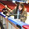 Maria and Joe Hackett decorate the 1980 Rink boards with colorful bunting for the opening of the Empire State Games today in Lake Placid.<br><br>(P-R Photo/Pat Hendrick)