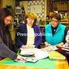 Carole Prevost-Meier (left to right) and Champlain Valley Quilter's Guild of New York members Violet Moesch, Maggie Talford and Barb Stadnicki discuss fabrics and patterns at Meier's shop, called Fibre Junction, in Rouses Point Saturday afternoon. <br><br>(P-R Photo/Gabe Dickens)