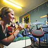 Casey Skrhak (left) sings along to the music of the Guitar Hero electronic game, as Teresa Atiencia (center) and  Page Moody accompany her, at the Saranac Lake Youth Center. <br><br>(P-R Photo/Jack LaDuke)