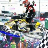 Jason Stone of Central Square, N.Y., soars high above the crowd as he completes a lap on his Ski-Doo snowmobile during a Pro Stock race.<br><br>(P-R Photo/Gabe Dickens)