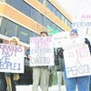Members of the Progressive Coalition of Northern New York gather on the corner of Broad and Durkee streets in Plattsburgh Friday afternoon to protest Citizens United v. Federal Election Commission.<br><br>(P-R Photo/Andrew Wyatt)
