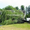 A large willow tree uprooted by a severe thunderstorm Wednesday afternoon reclines across a yard on Ashton Drive in Morrisonville, practically obscuring the home there.<br><br>(P-R Photo/Gabe Dickens)