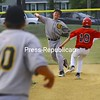 City Police second baseman Adam Goldfarb tosses the ball to teammate Durgan Zapalla after completing the first half of a double play Monday in Babe Ruth semifinal action. City Police won the first game of the series, 12-8. City Fire's Cam Rock is pictured attempting to reach second.<br><br>(Staff Photo/Kelli Catana)