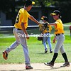 Alex Follmer (left) congratulates Ryan Criss, both of the Plattsburgh Little League 11-12 All-Stars on making an out during a game against the Montreal NDG Lynx. Plattsburgh split the nonleague doubleheader. Bonus photos will be available midday Monday at pressrepublicanphotos.com.<br><br>(P-R Photo/Gabe Dickens)