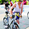 Keeseville native Jacob Painter transitions to the 112-mile bicycle portion of the Ford Ironman Lake Placid triathlon Sunday. Painter, 22, was among one of the top local finishers.<br><br>(P-R Photo/Rob Rountain)