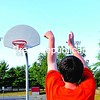 """Troy Hassinger launches a basketball from three-point land at Melissa Penfield Park in Plattsburgh. """"I like to play basketball for exercise, but mostly for fun,"""" he said.<br><br>(P-R Photo/Rob Fountain)"""