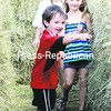 Lincan Stone leads sister Cameron (right) and Bailey Martin through the hay-bale maze at Saturday's 10th annual Redneck Games in Malone.<br><br>(P-R Photo/Pat Hendrick)