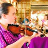 """Emily Allen performs """"Keep Holding On"""" on her violin during the Plattsburgh Farmers and Crafters Market. Allen, who has played the instrument for 10 years, said it was fun to play for everyone. The downtown market offers local produce, crafts, food and more every Wednesday and Saturday.<br><br>(P-R Photo/Rob Fountain)"""