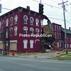 A section of a condemned building that once housed Nikki's Bar at the corner of Route 11 and Academy streets in Malone collapsed about 2:45 a.m. Monday, spilling bricks and debris onto the pavement. No one was injured, but a state of emergency has been declared by Mayor Brent Stewart.<br><br>(Staff Photo/Denise A. Raymo)