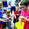 Colby Adams, 8 of Plattsburgh hands out candy during Plattsburgh's Fourth of July parade.<br><br>(Staff Photo/Kelli Catana)