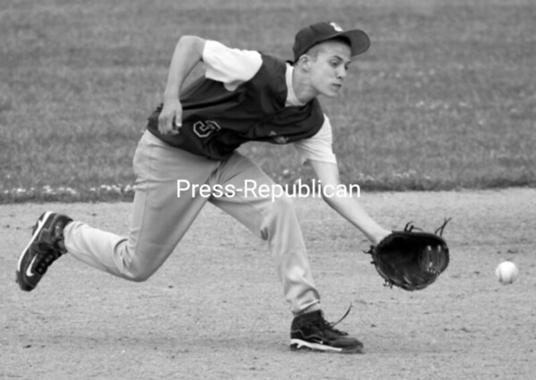 McSweeney's infielder Garrett Frady comes up with a grounder before throwing the runner out at first base during Wednesday's Plattsburgh Babe Ruth game against Play It Again Sports. McSweeney's recorded a 5-3 victory.<br><br>(P-R Photo/Gabe Dickens)