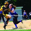 Peru's Paige Moore tags out Samantha Brown of Canton in the NYSPHSAA Class B softball regional semifinals at Cardinal Park. The Golden Bears defeated the Indians, 8-1. Bonus photos will be available at midday at pressrepublicanphotos.com.<br><br>(Staff Photo/Kelli Catana)