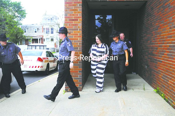 Kathryn Shoemaker is escorted from Clinton County Court Wednesday after being sentenced to life without parole for the August 2009 murder of Ravin Miller. She was convicted of all possible charges for Miller's death and was found to have strangled him inside his Route 11 home to prevent him from reporting her theft of $35,000 from him. At the time, Miller, a local contractor, was helping Shoemaker financially in starting a trucking business. She showed no reaction when the sentence was announced and plans to appeal.<br><br>(Staff Photo/Kelli Catana)