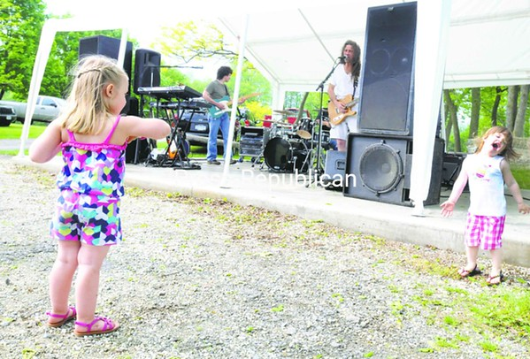 "Cloe Combs (left), 3, and Hayden Wilson, 2, put the ""happy"" into Happy Pike festivities last weekend in Chazy. The annual weekend festival draws many area residents to the town fishing competition, live music and outdoor games. <br><br>(P-R Photo/Andrew Wyatt)"