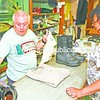Sagan's Department Store owner, Jack Woods, checks out purchases for Kathy Wagstaff on one of the downtown-anchor store's last days in business.<br><br>(Staff Photo/Lohr McKinstry)