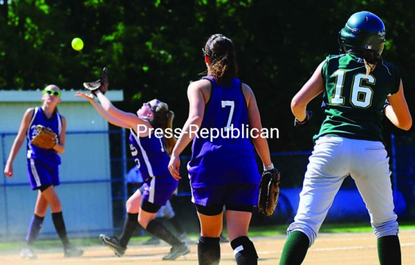 Ticonderoga's Calsie Granger (13) settles under a weak pop-fly with teammate Taylor Ward (7) and Norwood-Norfolk's Alycia Short (16) looking on during a NYSPHSAA Class C regional semifinal softball game at Plattsburgh State's Cardinal Park on Monday. The Flyers won, 10-3. Bonus photos will be available at midday at pressrepublicanphotos.com.<br><br>(Staff Photo/Kelli Catana)