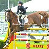 Monsieur du Reverdy, shown by Victoria Colvin, just clears the top rail on the way to a runner-up finish in the high junior jumper II competition Wednesday at the North Elba Showgrounds.<br><br>(P-R Photo/Pat Hendrick)