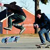 Evan Davis (left), 18, and Ian Bellerive, 16, skateboard in the U.S. Oval parking lot in Plattsburgh. The two took turns recording each other performing tricks, which they said they would edit into a video. The effort was challenged by brisk winds that threw them off balance and the cold day, too. To avoid injury, skateboarders should wear helmets and pads.<br><br>(P-R Photo/Gabe Dickens)