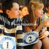 Declan Giltz, a fourth-grader from Beekmantown Central School and Caitlynne Perry, a fourth-grader from Willsboro Central, wait their turn during the Regional Spelling Bee competition.<br><br>(P-R Photo/Andrew Wyatt)