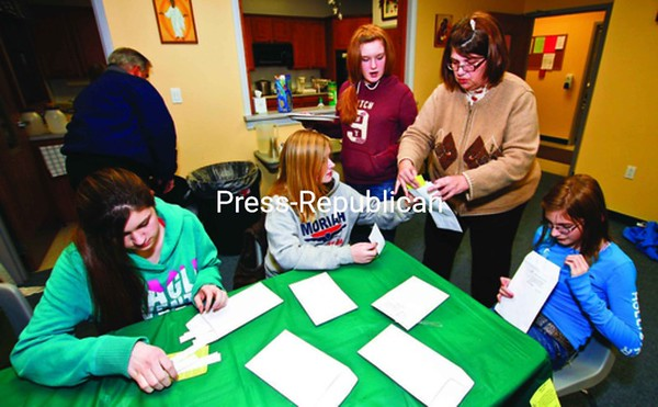 Working on the Crosses for the Fallen project at St. Patrick's Church in Port Henry are: Shelby MacDougal (from left), Blake Bigelow, Lauren Cross, coordinator Lorraine Turgeon and Caitlin Pelkey. <br><br>(Staff Photo/Lohr McKinstry)