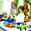 Daniel Dumont, 3; Alaire Allen, 3; Alexander Sirk, 2; Zachery Sirk, 2; and Tom Sorensen, 3; play with Laurie Booth-Trudo, coordinator of Family Connections Resource Center in Plattsburgh during a recent Parent/Child Playgroup.<br><br>(Staff Photo/Kelli Catana)