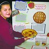 """Emma Disorgra shows off her """"apple"""" pie made from Ritz crackers as part of her informative display in the Elizabethtown Lewis Central School Science Fair. Her entry garnered first place overall; the judges felt she'd made the most thorough investigation.<br><br>(Staff Photo/Alvin Reiner)"""