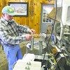 Wayne Brow of Brow's Sugar House in West Chazy checks the sugar content of his syrup. He says this year's crop is very good in both quality and quantity. Brow operates 150 acres and boils the sap at his 89 Sugarbush Drive location.<br><br>(P-R Photo/Bruce Rowland)