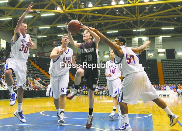 Chateaugay's Michael Boyea (10) splits the New York Mills' defense of Jacob Kehrli (30) Matt Welch (52) and Fred Russ (50) for a lay-up during Friday's NYSPHSAA Class D Final Four semifinal at the Glens Falls Civic Center. Bonus pictures will be available midday at pressrepublicanphotos.com.<br><br>(P-R Photo/Andrew Wyatt)