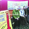 Saranac Lake Community Store officers Vice President Gail Brill, Board President Melinda Little, Treasurer Alan Brown and Director-At-Large Lorraine Duvall sit next to a sign announcing the success of their fundraising campaign.<br><br>(P-R Photo/Jack LaDuke)