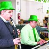 Ron Gregoire (left) and Ron Duffy perform at St. Patrick's Church in Rouses Point during the annual St. Patrick's Festival Sunday afternoon, which is the church's lone fundraiser. Volunteers dished out around 200 turkey dinners, and guests bought tickets for a chance to win one of many prizes, including a 46-inch LCD television and a Nintendo Wii gaming system bundle. Kids games and vendors selling jewelry, crafts and fudge were also on hand.<br><br>(P-R Photo/Gabe Dickens)
