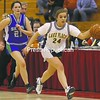 Lake Placid's Mackenzie Kemmerer (24) races down the court during the Section VII Class C girls' basketball championship game Friday at the Plattsburgh State Field House. Lake Placid won and will play Section X's Madrid-Waddington tonight in the NYSPHSAA playoffs.<br><br>(P-R Photo/Gabe Dickens)