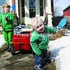 Declan Kelley, 5, and Ronan Kelley, 15 months, enjoy a mix of sun and snow as they play outside their Plattsburgh home.<br><br>(P-R Photo/Andrew Wyatt)