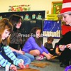 """Long-term substitute first-grade teacher Brittany Tribendis helps students create antlers after reflecting on """"Thudwick the Big-Hearted Moose"""" during Suess-Read Across America Day at Elizabethtown Lewis Central School. <br><br>(Staff Photo/Alvin Reiner)"""