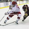 Plattsburgh State's Nick Jensen (14) tries to move around Norwich University's Blake Forkey (12) during the meeting between the two teams on Jan. 4 at the Stafford Ice Arena. The Cardinals won the game, 7-4, and will oppose the Cadets tonight in the NCAA Division III Tournament quarterfinals in Plattsburgh.<br><br>(P-R Photo/Gabe Dickens)