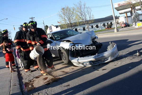 City police clean up after a two-car crash on South Catherine Street. At least one person was transported to CVPH Medical Center from the 6 p.m. crash Sunday. No additional information about the accident was available Sunday evening.<br><br>(P-R Photo/Clayton Smalley)
