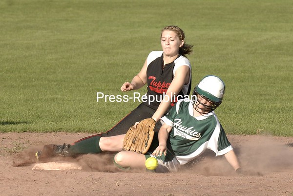 Hailey Trim of Malone slides safely into second base during the final inning as the ball squirts away from Tupper Lake's Kelsie St. Louis.<br><br>(P-R Photo/Pat Hendrick)