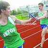 Seton Catholic's Rayne Fuller (right) hands the baton off to teammate Zach Ziemer during the 1,600-meter relay during a track and field meet against EKMW Tuesday at Plattsburgh High School. Ziemer and Fuller won the race with Justin Bresette and Ryan Lawrence. The Seton Catholic boys won, but EKMW won the girls' meet.<br><br>(P-R Photo/Andrew Wyatt)