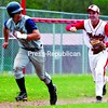 Lake Placid runner J.P. Morrison (12)  is caught in a rundown between third and home as Saranac third baseman Brady Burleigh (21) gives pursuit during Saturday's CVAC game. Morrison tried to score from second on a base hit to the outfield, but stopped between home and third when the ball was waiting for him at the plate. The Chiefs rolled to a 14-0 win.<br><br>(P-R Photo/Gabe Dickens)