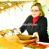 Patricia Parker, manager of the Plattsburgh Farmers and Crafters Market, sets up the Parker Family Maple Farm and Gifts booth at the Durkee Street pavilion, preparing to open for the season Saturday.<br><br>(Staff Photo/Kelli Catana)